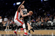 Tyler Zeller #44 of the Brooklyn Nets works against Hassan Whiteside #21 of the Miami Heat in the first quarter during their game at Barclays Center on January 19, 2018 in the Brooklyn borough of New York City. NOTE TO USER: User expressly acknowledges and agrees that, by downloading and or using this photograph, User is consenting to the terms and conditions of the Getty Images License Agreement.