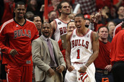 (L-R) Kurt Thomas #40, John Lucas III, Joakim Noah #13 and Derrick Rose #1 of the Chicago Bulls celebrate late in the fourth quarter against the Miami Heat in Game One of the Eastern Conference Finals during the 2011 NBA Playoffs on May 15, 2011 at the United Center in Chicago, Illinois. The Bulls won 103-82. NOTE TO USER: User expressly acknowledges and agrees that, by downloading and or using this photograph, User is consenting to the terms and conditions of the Getty Images License Agreement