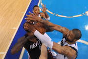 LeBron James #6 of the Miami Heat draws contact from Tyson Chandler #6 and Shawn Marion #0 of the Dallas Mavericks in the second half of Game Five of the 2011 NBA Finals at American Airlines Center on June 9, 2011 in Dallas, Texas.  NOTE TO USER: User expressly acknowledges and agrees that, by downloading and/or using this Photograph, user is consenting to the terms and conditions of the Getty Images License Agreement.