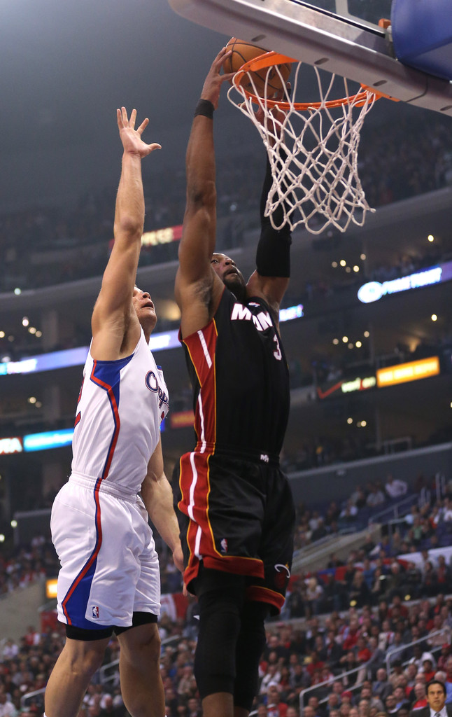 Chris bosh dunked on by blake griffin