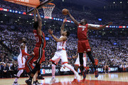 DeMar DeRozan #10 of the Toronto Raptors drives to the basket as Justice Winslow #20 and Luol Deng #9 of the Miami Heat defend in Game Seven of the Eastern Conference Quarterfinals during the 2016 NBA Playoffs at the Air Canada Centre on May 15, 2016 in Toronto, Ontario, Canada.  NOTE TO USER: User expressly acknowledges and agrees that, by downloading and or using this photograph, User is consenting to the terms and conditions of the Getty Images License Agreement.