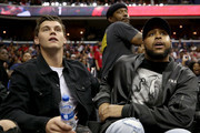 Andre Burakovsky (L) and  Devante Smith-Pelly look on while the Washington Wizards play the Miami Heat during the Washington Wizards home opener at Capital One Arena on October 18, 2018 in Washington, DC. NOTE TO USER: User expressly acknowledges and agrees that, by downloading and or using this photograph, User is consenting to the terms and conditions of the Getty Images License Agreement.