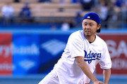 Olympic swimmer Kosuke Kitajima of Japan throws out a ceremonial first pitch before the game against the Miami Marlins at Dodger Stadium on May 18, 2017 in Los Angeles, California.