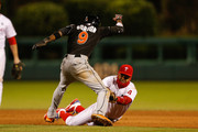 Dee Gordon #9 of the Miami Marlins is caught steeling by Andres Blanco #4 of the Philadelphia Phillies in the ninth inning of the second game of a double header at Citizens Bank Park on October 3, 2015 in Philadelphia, Pennsylvania. The Marlins won 5-2.