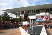Roger Federer of Switzerland celebrates with the winners trophy after his final win against John Isner of USA during day fourteen of the Miami Open tennis on March 31, 2019 in Miami Gardens, Florida.