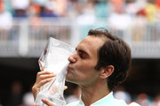 Roger Federer of Switzerland poses with the winners trophy after defeating John Isner in straight sets during the Men's Final match on day 14 of the Miami Open presented by Itau at Hard Rock Stadium on March 31, 2019 in Miami Gardens, Florida.
