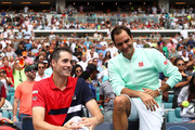 Winner Roger Federer of Switzerland sits with runner up John Isner of USA after the final during day fourteen of the Miami Open tennis on March 31, 2019 in Miami Gardens, Florida.