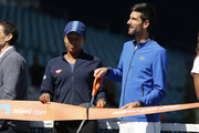 Naomi Osaka of Japan and Novak Djokovic of Serbia cut the ribbon during the Ribbon Cutting ceremony on Day 3 of the Miami Open Presented by Itau on March 20, 2019 in Miami Gardens, Florida.