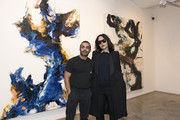 """(L-R) Artist Michael Angel and Patricia Black attend Michael Angel's """"Maps and Stacks"""" Presented by Gobbi Fine Art on October 10, 2019 in New York City."""