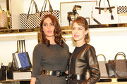 Catrinel Marlon and Elena Radonicich attend Michael Kors To celebrate Milano opening on December 4, 2013 in Milan, Italy.