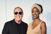 Michael Kors and Justine Skye pose backstage during the Michael Kors Collection Spring 2020 Runway Show on September 11, 2019 in Brooklyn City.