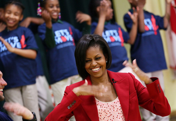 First Lady Promotes Youth Exercise With Olympians [people,red,youth,community,event,fun,smile,performance,recreation,talent show,michelle obama,alana nichols,schoolchildren,olympians,activity,element,u.s.,river terrace school,first lady promotes youth exercise with olympians,school]