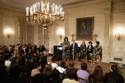 "First Lady Michelle Obama (L) delivers remarks during s workshop titled ""I'm Every Woman: The History of Women in Soul"" with (L-R) Grammy Museum Executive Director Robert Santelli, and music artists Melissa Etheridge, Janelle Monae and Patti LaBelle in the State Dining Room at the White House March 6, 2014 in Washington, DC. As part of a concert honoring women in soul music, Obama hosted the workshop for 124 students from middle school, high school and colleges from across the country."