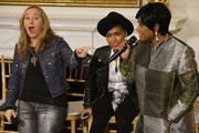 "(L-R) Music artists Melissa Etheridge and Janelle Monae react with surprise when soul icon Patti LaBelle offers to sing during a workshop titled ""I'm Every Woman: The History of Women in Soul"" in the State Dining Room at the White House March 6, 2014 in Washington, DC. As part of a concert honoring women in soul music, First Lady Michelle Obama hosted the workshop for 124 students from middle school, high school and colleges from across the country."