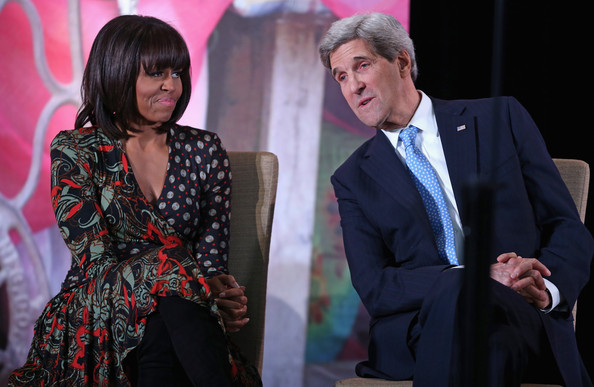 """Michelle Obama U.S. first lady Michelle Obama (L) and U.S. Secretary of State John Kerry host the International Women of Courage awards ceremony at the State Department March 8, 2013 in Washington, DC. In celebration of the 102nd International Women's Day, the State Department honored nine women from around the world with the International Women of Courage Award, including the 23-year-old Indian woman known only as """"Nirbhaya,"""" who died from injuries she received after being gang raped by six men last December in Delhi."""