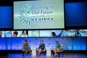 Former first lady Laura Bush (C), U.S. first lady Michelle Obama (L) and journalist Cokie Roberts participate in a Spousal Symposium at the John F. Kennedy Center for the Performing Arts on August 6, 2014 in Washington, DC. The symposium, sponsored by first lady Michelle Obama and former first lady Laura Bush, focuses on the role the spouses of world leader's play and the impact of investments in education, health, and economic development through public-private partnerships.