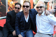 Producer Mark Canton, actor Mickey Rourke and producer Gianni Nunnari attend Micky Rourke's Hand and Footprint Ceremony held at Grauman's Chinese Theatre on October 31, 2011 in Hollywood, California.