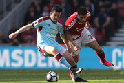 Joey Barton of Burnley (L) and Rudy Gestede of Middlesbrough (R) battle for possession during the Premier League match between Middlesbrough and Burnley at Riverside Stadium on April 8, 2017 in Middlesbrough, England.