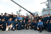 Cast and crew from the film Midway stand with a group of sailors aboard the USS Halsey on October 20, 2019 in Honolulu, Hawaii.