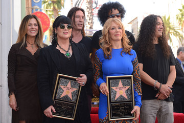 Mike Inez Ann Wilson And Nancy Wilson Honored On The Hollywood Walk Of Fame