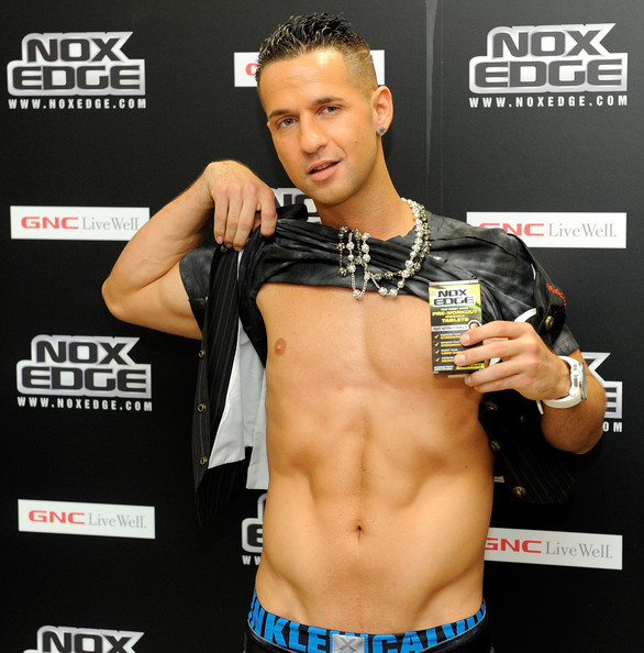 "Mike Sorrentino Mike ""The Situation""  Sorrentino shows of his trademark abs during the NoX Edge supplement  launch at GNC on July 1, 2010 in New York City."