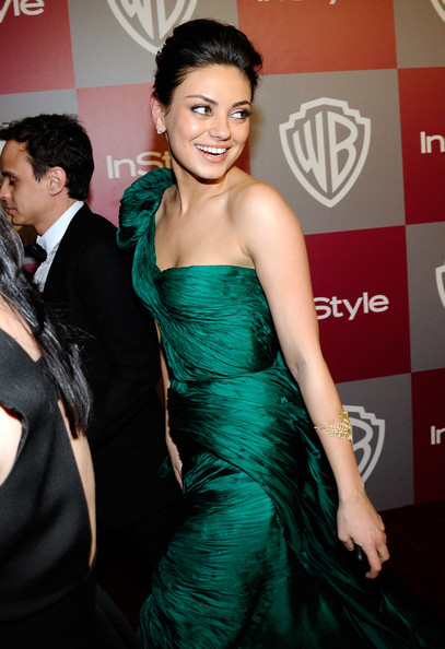 Mila Kunis Actress Mila Kunis arrives at the 2011 InStyle And Warner Bros.