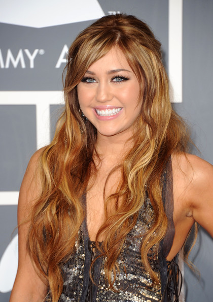 Miley Cyrus Actress-singer Miley Cyrus arrives at The 53rd Annual GRAMMY Awards held at Staples Center on February 13, 2011 in Los Angeles, California.