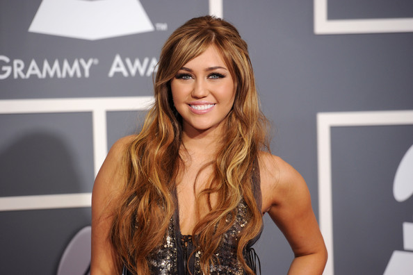 Miley Cyrus Singer Miley Cyrus arrives at The 53rd Annual GRAMMY Awards held at Staples Center on February 13, 2011 in Los Angeles, California.