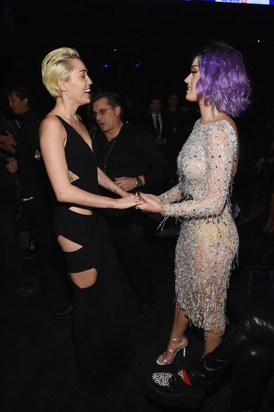 The 57th Annual GRAMMY Awards - Backstage [fashion,dress,lady,fun,event,blond,leg,human body,formal wear,performance,singer-songwriters,katy perry,miley cyrus,backstage,california,los angeles,staples center,l,57th annual grammy awards,the 57th annual grammy awards]
