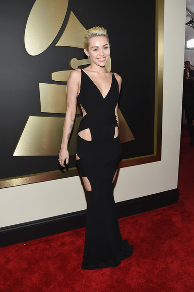 The 57th Annual GRAMMY Awards - Red Carpet [red carpet,red carpet,dress,carpet,clothing,shoulder,fashion,flooring,fashion model,little black dress,cocktail dress,miley cyrus,california,los angeles,staples center,57th annual grammy awards,the 57th annual grammy awards]