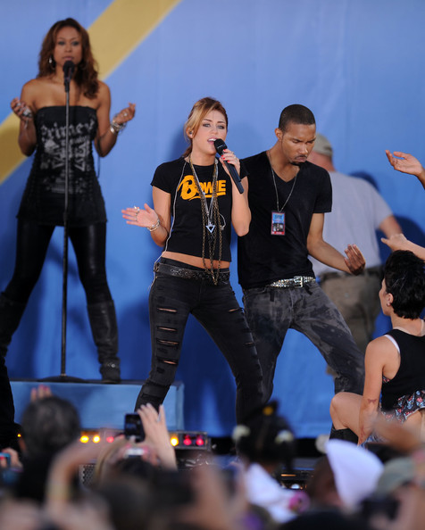 "Miley Cyrus Singer Miley Cyrus performs on ABC's ""Good Morning America"" at Rumsey Playfield, Central Park on June 18, 2010 in New York City."