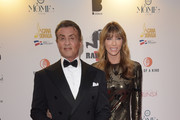 (L-R) Sylvester Stallone and Jennifer Flavin attend Millennium Media Dinner And Cocktail Reception In Honor Of   Sylvester Stallone on May 24, 2019 in Cannes, France.