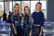 Morgan Stewart, Christie Ferrari and Katherine McNamara attend the Milly by Michelle Smith front row during New York Fashion Week: The Shows at Gallery II at Spring Studios on September 7, 2018 in New York City.