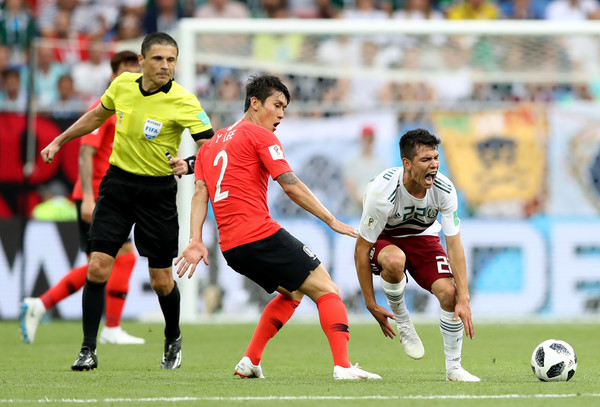 Korea Republic vs. Mexico: Group F - 2018 FIFA World Cup Russia [player,sports,soccer player,sports equipment,soccer,team sport,ball game,football,sport venue,football player,yong lee,hirving lozano,korea republic,russia,mexico,rostov-on-don,rostov arena,group,mexico: group f - 2018 fifa world cup,match]