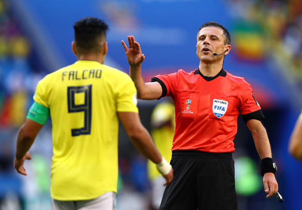 Senegal vs. Colombia: Group H - 2018 FIFA World Cup Russia [referee,player,football player,team sport,football,sports,ball game,soccer player,sports equipment,milorad mazic,radamel falcao,senegal v,russia,colombia,samara arena,group,colombia: group h - 2018 fifa world cup,match,2018 fifa world cup]