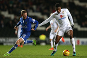 Paul Green of Oldham Athletic closes down Chuks Aneke of MK Dons during the Sky Bet League One match between Milton Keynes Dons and Oldham Athletic at StadiumMK on February 7, 2017 in Milton Keynes, England.