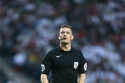 Referee Robert Jones in action during the Carabao Cup Second Round match between Milton Keynes Dons and Swansea City at StadiumMK on August 22, 2017 in Milton Keynes, England.