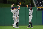 Curtis Granderson #28 of the Milwaukee Brewers celebrates with Christian Yelich #22 and Keon Broxton #23 after the final out in an 8-3 win over the Pittsburgh Pirates at PNC Park on September 21, 2018 in Pittsburgh, Pennsylvania.