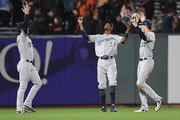(L-R) Ryan Braun #8, Keon Broxton #23 and Christian Yelich #22 of the Milwaukee Brewers celebrates defeating the San Francisco Giants 3-1 at AT&T Park on July 27, 2018 in San Francisco, California.