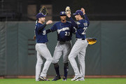 (L-R) Ryan Braun #8, Keon Broxton #23 and Christian Yelich #22 of the Milwaukee Brewers celebrates defeating the San Francisco Giants 7-5 at AT&T Park on July 26, 2018 in San Francisco, California.