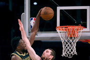 Julius Randle #30 of the Los Angeles Lakers dunks over Tyler Zeller #44 of the Milwaukee Bucks during the first half at Staples Center on March 30, 2018 in Los Angeles, California.