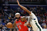 DeMarcus Cousins #0 of the New Orleans Pelicans drives the ball around Tony Snell #21 of the Milwaukee Bucks at Smoothie King Center on December 13, 2017 in New Orleans, Louisiana.