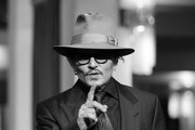 """Image was converted to black and white) Johnny Depp arrives for the """"Minamata"""" premiere during the 70th Berlinale International Film Festival Berlin at Friedrichstadt-Palast on February 21, 2020 in Berlin, Germany."""