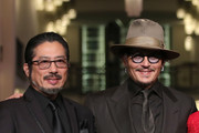 """(L-R) Hiroyuki Sanada and Johnny Depp arrive for the """"Minamata"""" premiere during the 70th Berlinale International Film Festival Berlin at Friedrichstadt-Palast on February 21, 2020 in Berlin, Germany."""