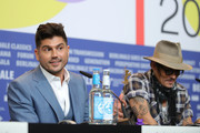 """(L-R) Andrew Levitas and Johnny Depp are seen at the """"Minamata"""" press conference during the 70th Berlinale International Film Festival Berlin at Grand Hyatt Hotel on February 21, 2020 in Berlin, Germany."""