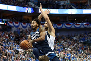 Derrick Rose #25 of the Minnesota Timberwolves takes a shot against Ryan Broekhoff #45 of the Dallas Mavericks at American Airlines Center on October 20, 2018 in Dallas, Texas.  NOTE TO USER: User expressly acknowledges and agrees that, by downloading and or using this photograph, User is consenting to the terms and conditions of the Getty Images License Agreement.