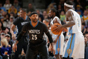 Mo Williams #25 of the Minnesota Timberwolves defends against Ty Lawson #3 of the Denver Nuggets at Pepsi Center on January 17, 2015 in Denver, Colorado. The Timberwolves defeated the Nuggets 113-105. NOTE TO USER: User expressly acknowledges and agrees that, by downloading and or using this photograph, User is consenting to the terms and conditions of the Getty Images License Agreement.