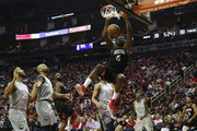 Clint Capela #15 of the Houston Rockets dunks the ball against Derrick Rose #25 of the Minnesota Timberwolves and Karl-Anthony Towns #32 in the first half during Game One of the first round of the 2018 NBA Playoffs at Toyota Center on April 15, 2018 in Houston, Texas.  NOTE TO USER: User expressly acknowledges and agrees that, by downloading and or using this photograph, User is consenting to the terms and conditions of the Getty Images License Agreement.