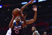 Jeff Teague #0 of the Minnesota Timberwolves attempts a shot in front of Tyrone Wallace #12 of the LA Clippers during the first half at Staples Center on January 22, 2018 in Los Angeles, California.