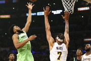 Karl-Anthony Towns #32 of the Minnesota Timberwolves shoots the ball as JaVale McGee #7 of the Los Angeles Lakers defends during the first half at Staples Center on December 08, 2019 in Los Angeles, California. NOTE TO USER: User expressly acknowledges and agrees that, by downloading and or using this photograph, User is consenting to the terms and conditions of the Getty Images License Agreement.